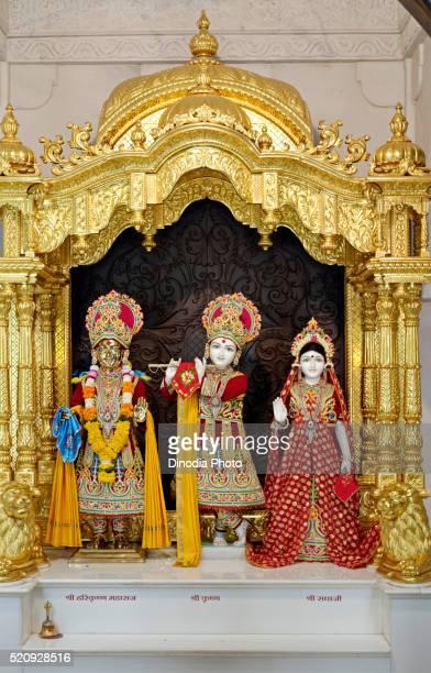 statue of radha krishna with harikrishna maharaja, swaminarayan temple, baps, gondal, rajkot district, saurashtra - radha krishna stock pictures, royalty-free photos & images