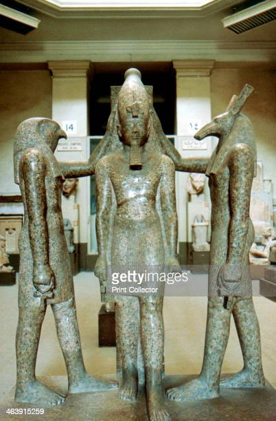 Statue of Rameses III Egypt Rameses portrayed as the god Osiris flanked by the falconheaded god Horus and the jackalheaded god Anubis Rameses III...