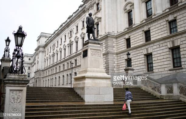 A statue of Robert Clive the 1st Baron Clive better known as Clive of India is pictured on Whitehall in central London on June 11 2020 Clive began...