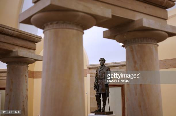 Statue of Robert E. Lee, commander of the Confederate States Army, is seen in the Crypt of the US Capitol in Washington, DC on June 11, 2020. - US...