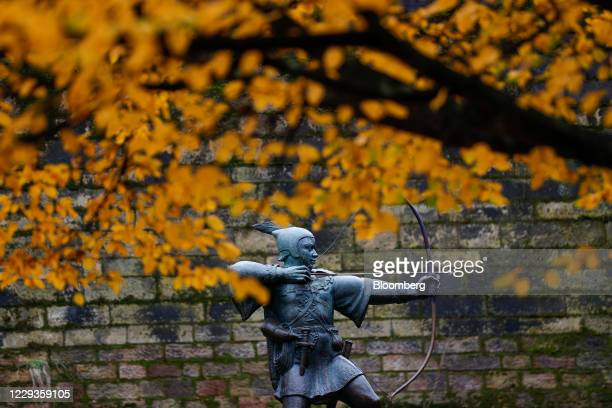 Statue of Robin hood stands outside Nottingham Castle as the city heads into the highest level of coronavirus restrictions, in Nottingham, U.K., on...