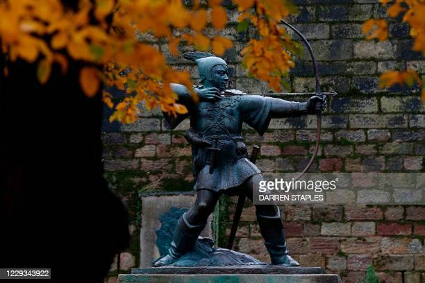 Statue of Robin Hood stands outside the Nottingham Castle in Nottingham, central England on October 29, 2020 as the city prepares to be moved into...