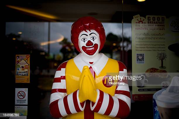 A statue of Ronald McDonald gesturing the traditional Thai wai greeting stands outside a McDonald's Corp outlet in Chiang Mai Thailand on Thursday...