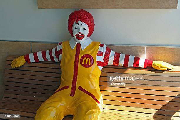 A statue of Ronald McDonald sits on a bench inside a McDonald's Corp restaurant in Oak Brook Illinois US on Friday July 12 2013 Don Thompson...