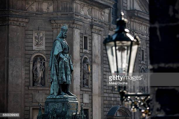 A statue of ruler Charles IV stands next to the Charles Bridge on May 9 2016 in Prague Czech Republic The Charles Bridge construction began in 1357...