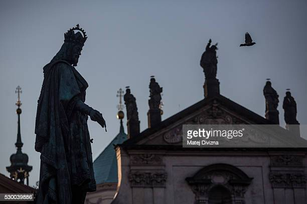 A statue of ruler Charles IV stands next to the Charles Bridge on May 10 2016 in Prague Czech Republic The Charles Bridge construction began in 1357...