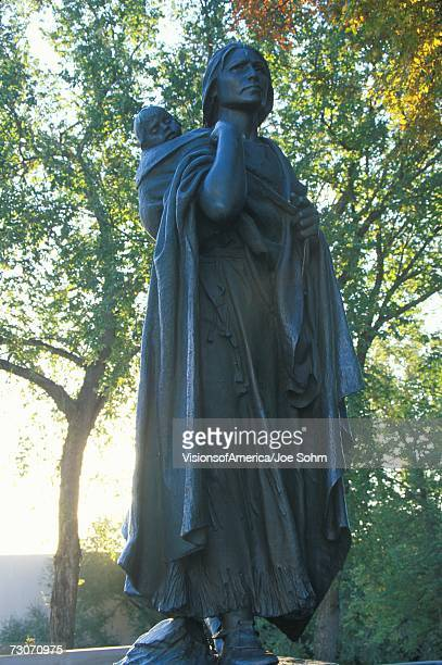 """""""statue of sacagawea and her son, guide on the lewis and clark expedition, bismarck, north dakota"""" - sacagawea stock pictures, royalty-free photos & images"""
