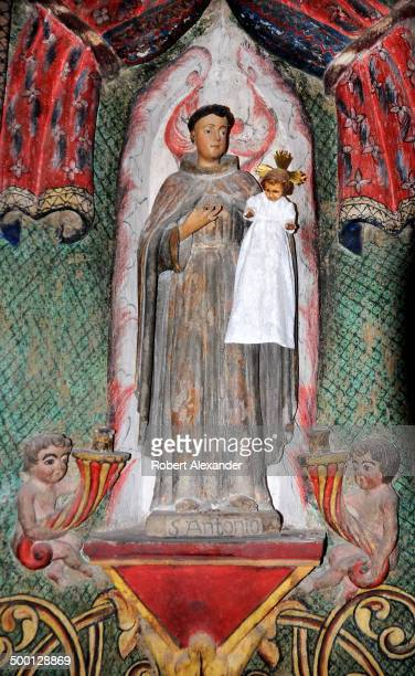 A statue of Saint Antonio or Saint Anthony at Mission San Xavier Del Bac on the Tohono O'odham Indian Reservation near Tucson Arizona The historic...