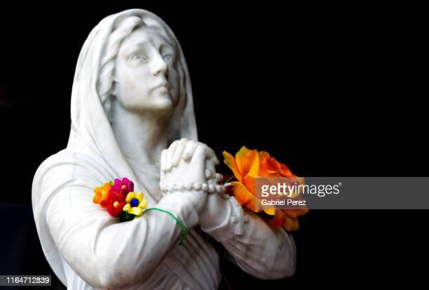 a statue of saint bernadette of lourdes - カトリック ストックフォトと画像