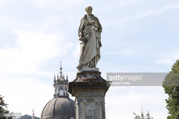 Statue of Saint Ignatius of Loyola in the foreground and the Sanctuary of Loyola with parts of the basilica in the background Basilica of Loyola next...