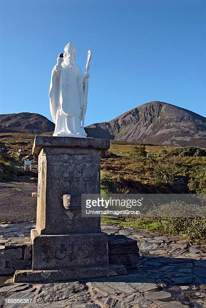 Statue of Saint Patrick at the base of Croagh Patrick the highest peak in Ireland at 2510 feet or 765 meters is also the holy mountain where Saint...