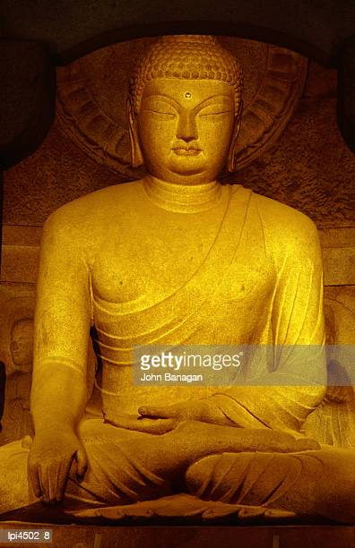 Statue of Sakyamuni Buddha in Seokguram (Sokkuram) Grotto, Front view, Bulguksa, South Korea