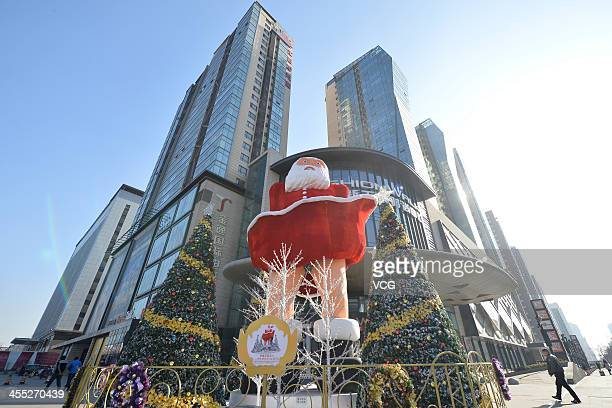 A statue of Santa Claus imitating Marilyn Monroe's famous pose stands in front of a shopping mall on December 11 2013 in Taiyuan China This idea is...