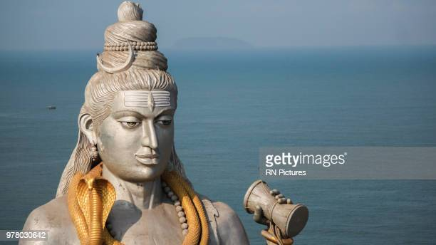 statue of shiva and sea in background, murudeshwara, india - shiva stock pictures, royalty-free photos & images