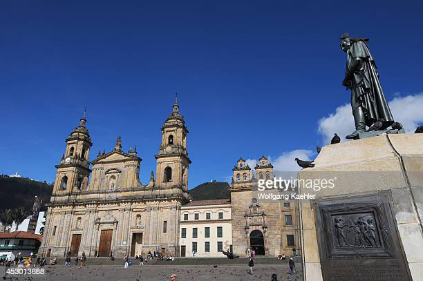 Statue of Simon Bolivar with the Archbishopric Cathedral of Bogota on Plaza de Bolivar in La Candelaria the old town of Bogota Colombia
