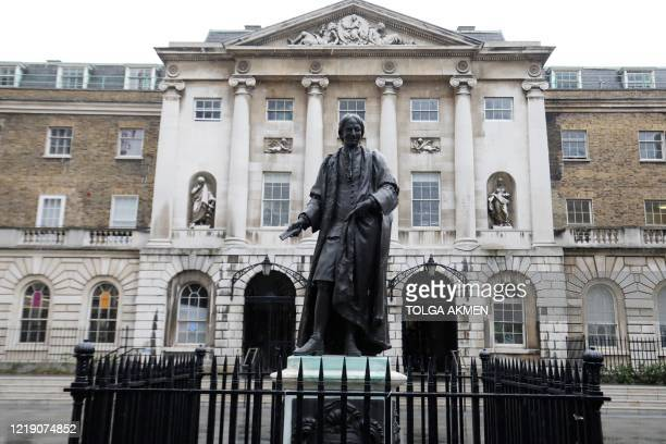 Statue of Sir Thomas Guy stands in the courtyard of the Guy's Hospital in central London on June 10, 2020. - Sir Thomas Guy made his fortune through...