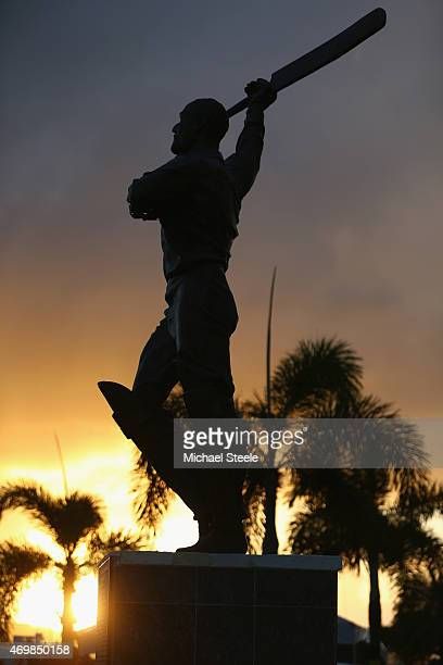 A statue of Sir Vivian Richards is seen at sunset outside the main entrance after day three of the 1st Test match between West Indies and England at...