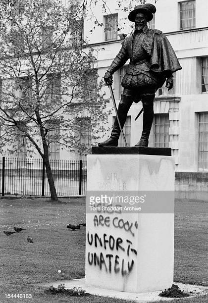 A statue of Sir Walter Raleigh defaced with graffiti during the May Day anticapitalist protest that caused thousands of pounds of damage to central...
