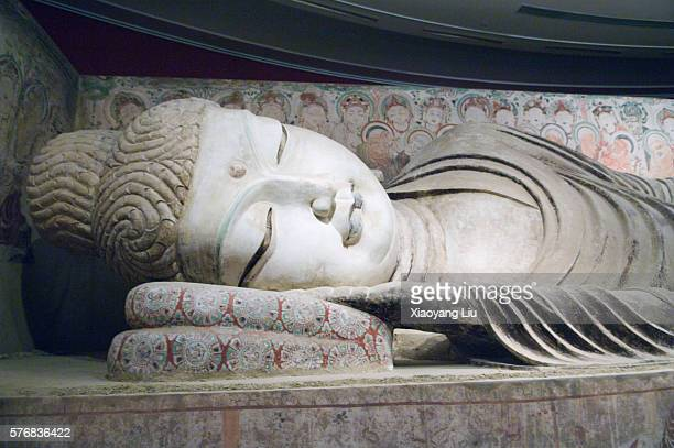 statue of sleeping buddha in mogao caves - mogao caves stock pictures, royalty-free photos & images