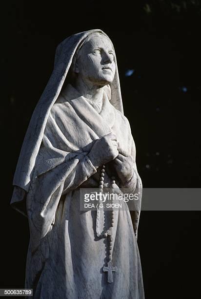 Statue of St Bernadette Soubirous , Lourdes, Midi-Pyrenees, France, 20th century.