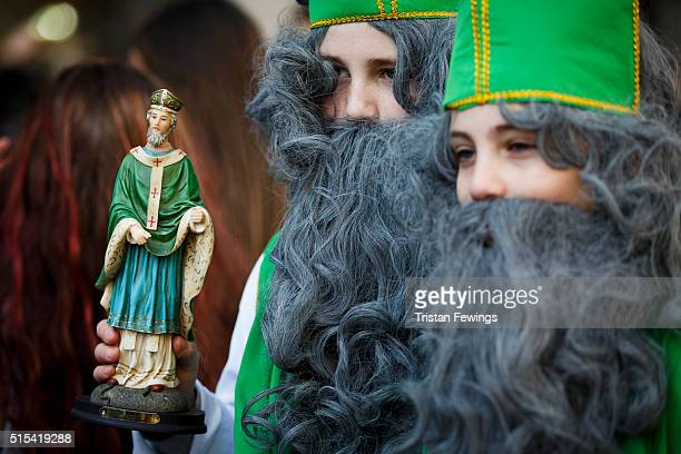 A statue of St Patrick is carried during the St Patrick's Day parade through central London on March 13 2016 in London England