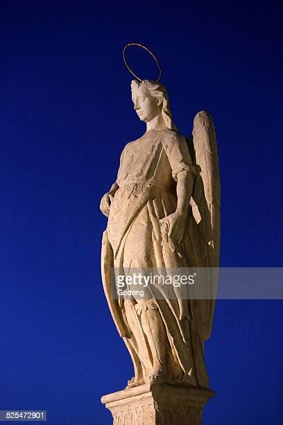 Statue of St Raphael on the Roman bridge in Cordoba Andalusia
