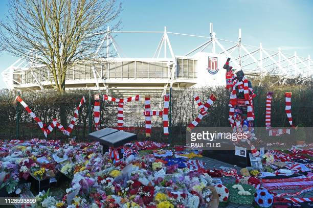TOPSHOT A statue of Stoke City and England's former goalkeeper Gordon Banks is pictured draped in scarves and surrounded by floral tributes to honour...