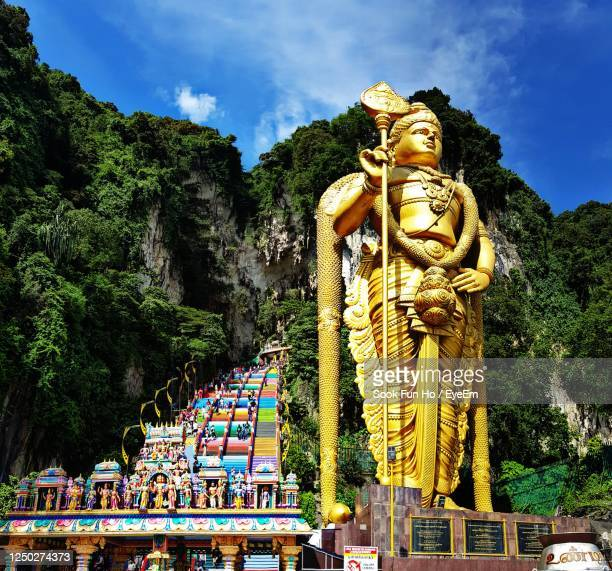 statue of temple against sky - kuala lumpur stock pictures, royalty-free photos & images