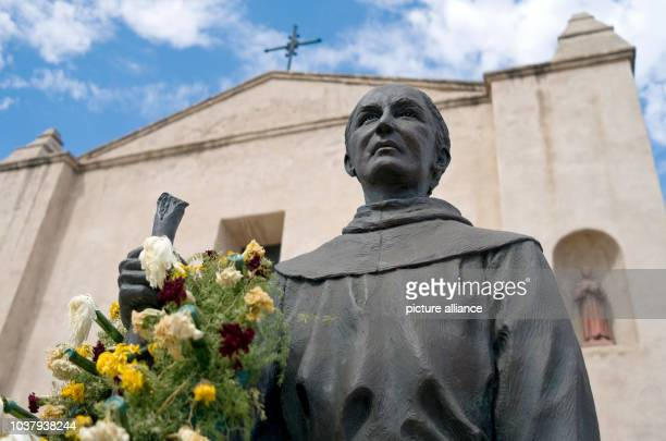 A statue of the 18th century Spanish missionary Junipero Serra holds watch at the mission of San Gabriel Arcangel in San Gabriel California The...