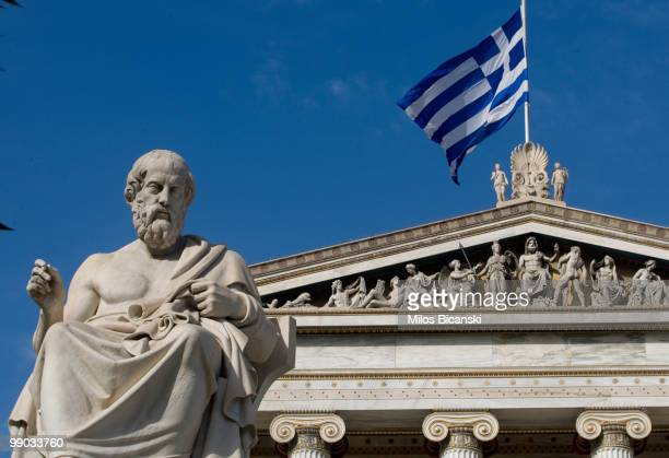 A statue of the ancient Greek philosopher Plato stands outside the Athens Academy one of the city's modern landmarks on May 11 2010 in central Athens...