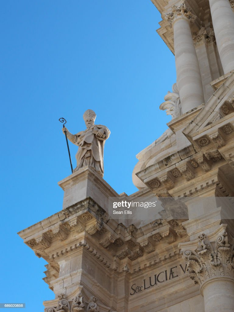 A statue of the Apostle Saint Paul on the Cathedral of Syracuse : Stock Photo