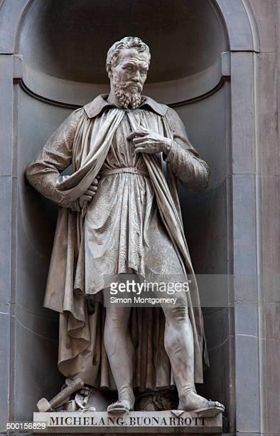 CONTENT] Statue of the artist Michelangelo Buonarroti in the Vasari Corridor outside the Uffizi Florence Italy