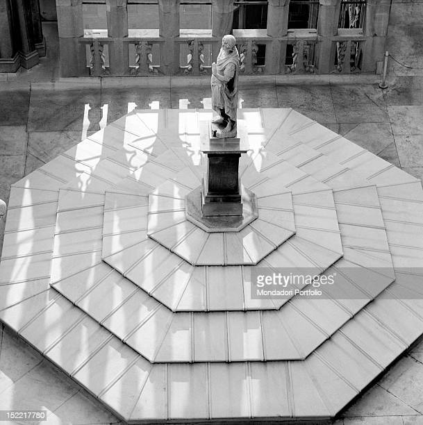 A statue of the Cathedral insert in an octagonal pedestal Milan 1964