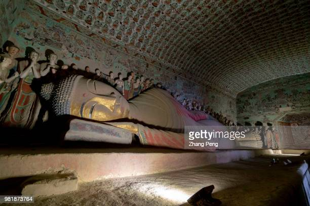 Statue of the final Nirvana of the Buddha. The Mogao Caves, also known as the Thousand Buddha Grottoes, are the best known of the Chinese Buddhist...