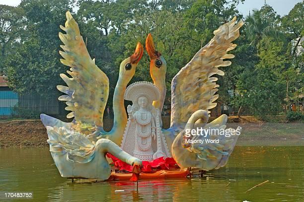 A statue of the Hindu goddess of Knowledge at Dhaka Universitys Jagannath Hall marking Saraswati Puja Dhaka Bangladesh February 11 2008