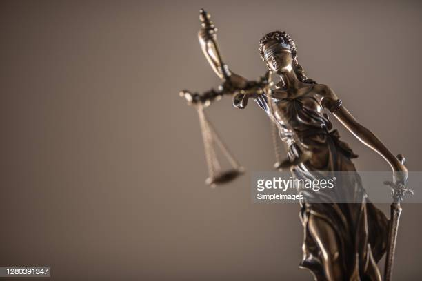 statue of the lady of justice with scales close-up. - lawyer stock pictures, royalty-free photos & images