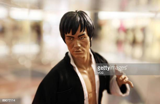 A statue of the late martial arts legend and movie star Bruce Lee are displayed at the Bruce Lee Collection Exhibition at the Plaza Hollywood on July...