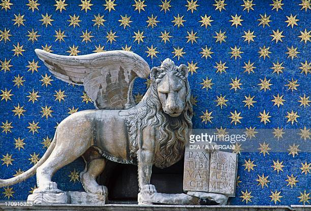 Statue of the Lion of St Mark on the Clock Tower St Mark's Square Venice Veneto Italy