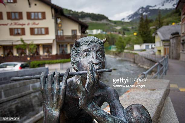 a statue of the mythical pan in the alps. - greek god stock pictures, royalty-free photos & images