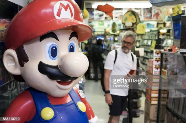 A statue of the Nintendo Co videogame character Mario stands on display at the Super Potato video game store in the Akihabara district of Tokyo Japan...