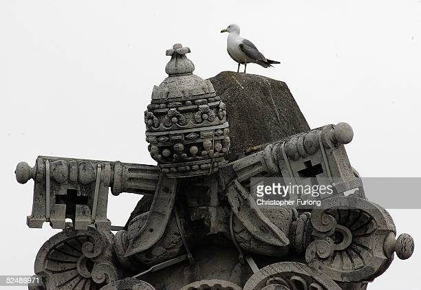 Statue of The Pope's tiara and keys to the Vatican in St Peter's Square, Vatican City, 28 March 2005. Thousands of catholic pilgrims waited in St...