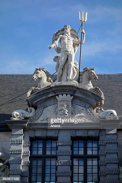 Statue of the Roman god Neptune with trident above the entrance to the Old Fish Market / Oude Vismijn in Ghent Belgium