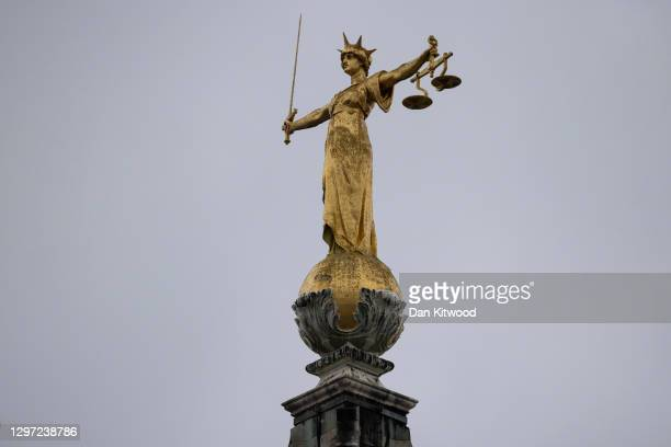 Statue of the Scales of Justice stands above the Old Bailey on January 19, 2021 in London, England. Criminal watchdogs representing England and Wales...