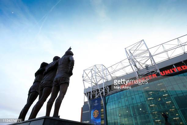 Statue of the United Trinity of George Best, Denis Law, and Sir Bobby Charlton at Old Trafford during the UEFA Champions League Round of 16 First Leg...