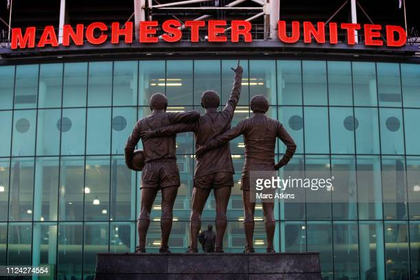 A statue of the United Trinity of George Best Denis Law and Sir Bobby Charlton at Old Trafford during the UEFA Champions League Round of 16 First Leg...