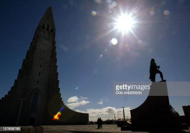 A statue of the Viking legend Leiv Eriksson and the tower of the landmark Hallgrim church are silhoueted 13 May 2002 in Reykjavik the capital of the...