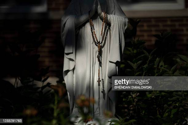 Statue of the Virgin Mary is seen with Rosary beads at Holy Trinity Catholic Church June 5 in Washington, DC.
