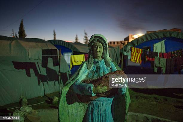 A statue of the Virgin Mary is surrounded by tents erected in the grounds of Mazar Mar Eillia Catholic Church in Ankawa that has now become home to...