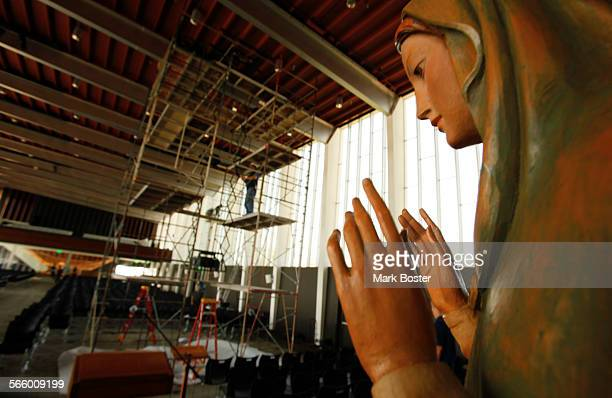 Statue of the Virgin Mary watches over the renovation underway at the Arboretum, designed by famed architect Richard Neutra on the grounds of the...