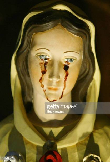 A statue of the Virgin Mary weeps a red liquid that Venezuelans say is blood March 25 2003 in Caracas Venezuela Hundreds of Venezuelans have flocked...